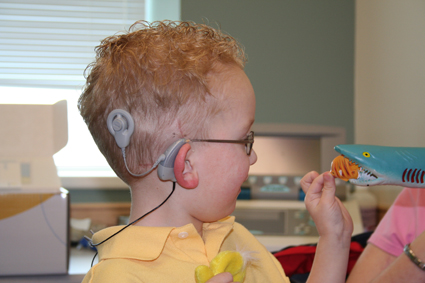 A child with a Cochlea implant. Photo (unchanged): Ryan Poole
